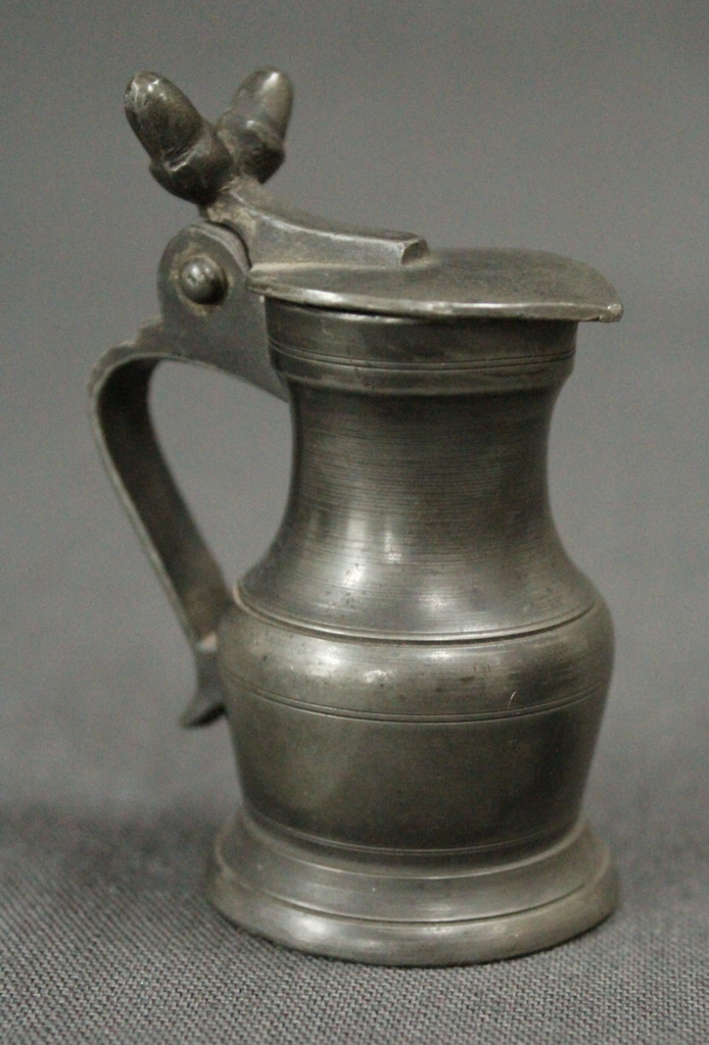 A small 19th Century pewter lidded measure