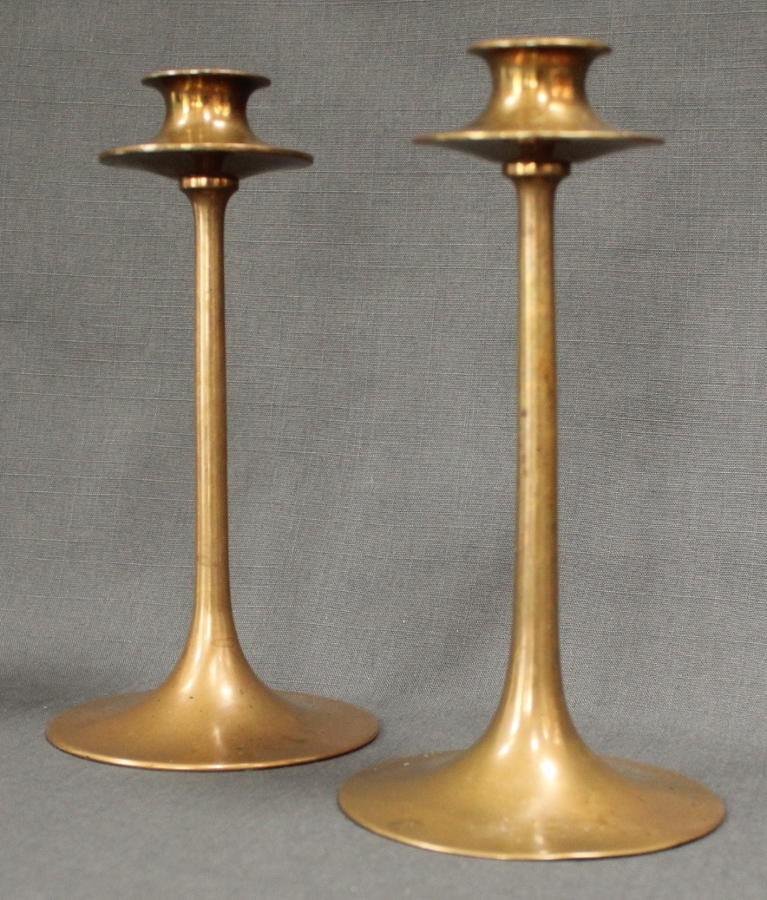 A pair of Arts & Crafts bronze candlesticks