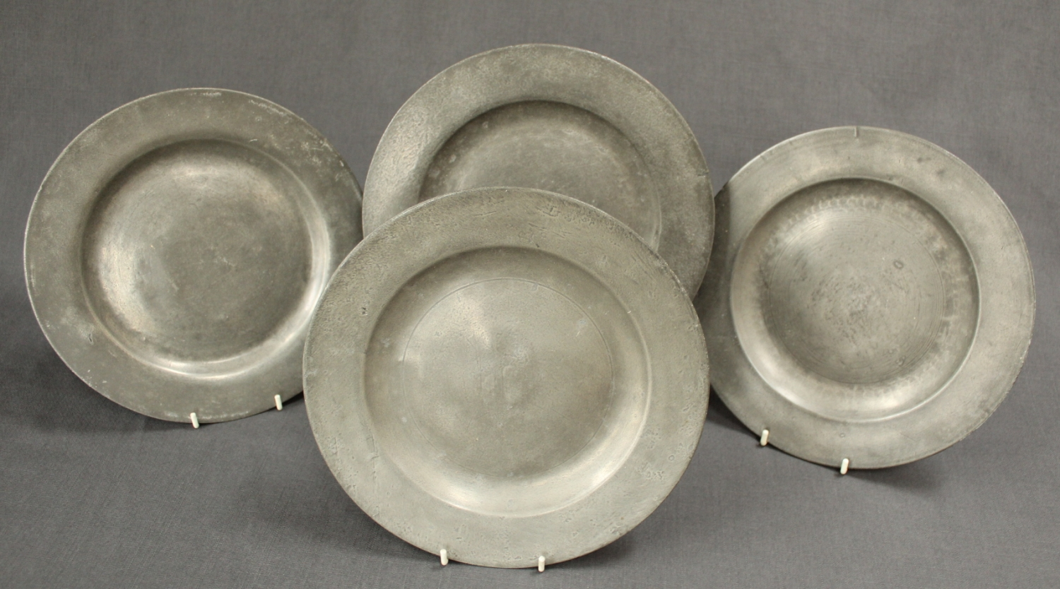 Four 19th Century pewter plates