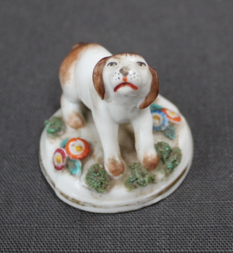 A small Samson figure of a dog