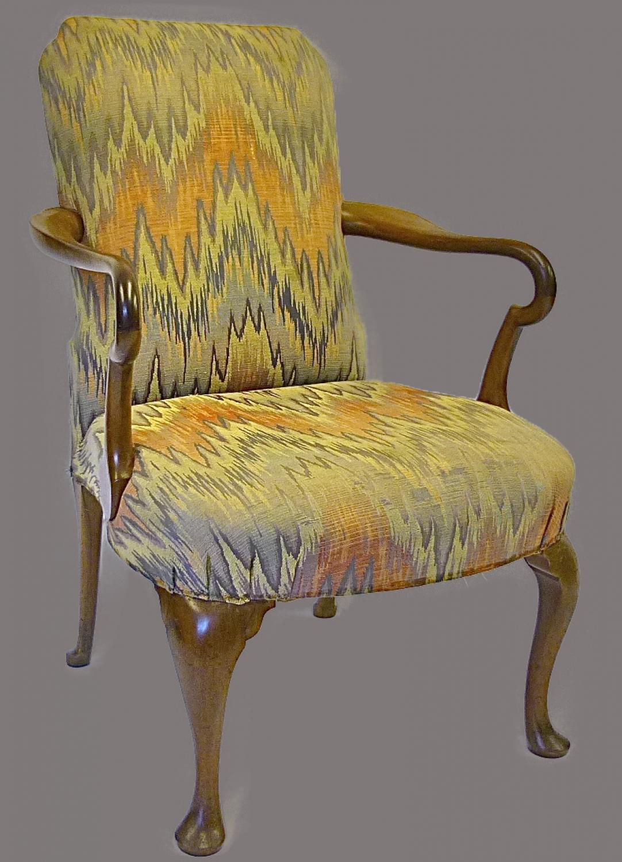 A walnut framed open elbow chair