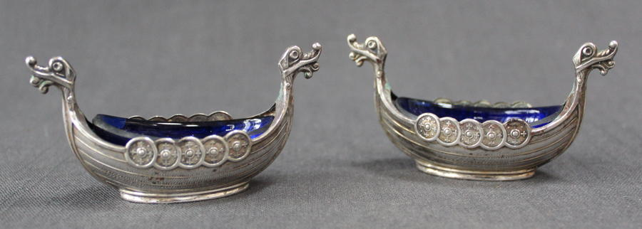 A pair of Viking long ship salt cellars