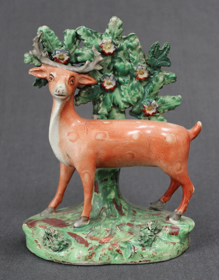 An early 19th Century bocage figure of a deer