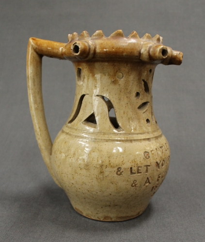 A buff glazed puzzle jug