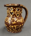 A glazed terracotta puzzle jug - picture 3