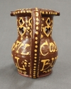 A glazed terracotta puzzle jug - picture 4