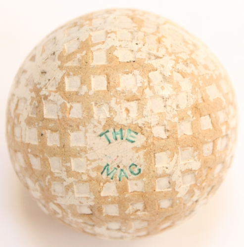 A Mac square mesh vintage golf ball