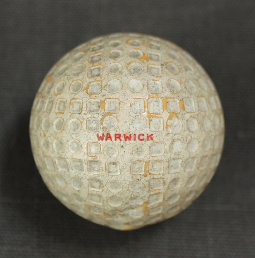 A Warwick square mesh and dot golf ball