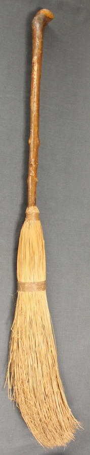 A vintage curling broom