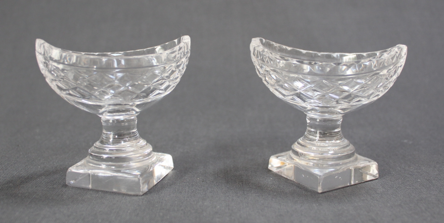 A pair of boat shaped glass salts