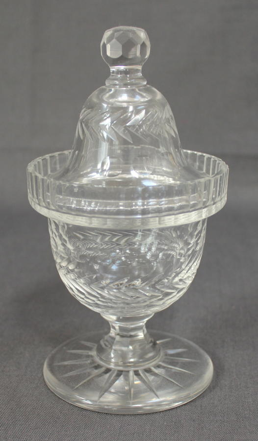 A clear glass sweetmeat jar
