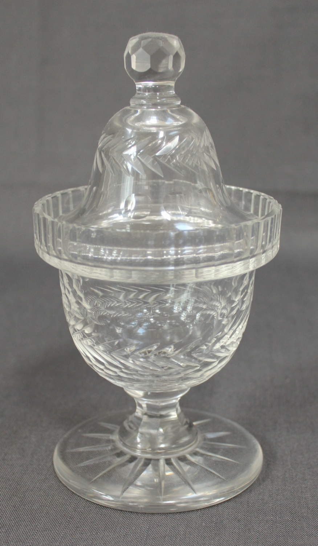 A clear glass sweetmeat jar