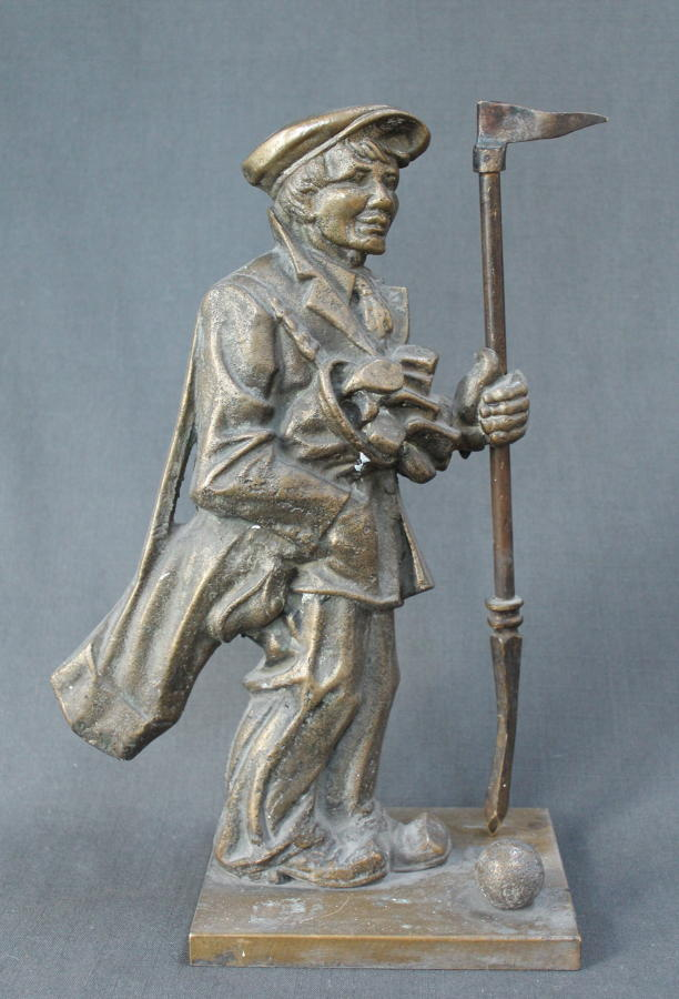 A cast metal 'golf caddie' companion stand