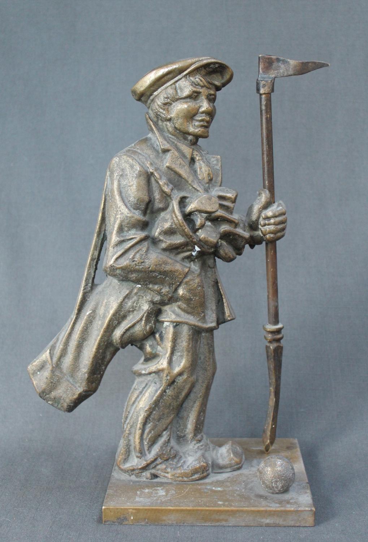 A cast metal 'golf caddie' companion stand