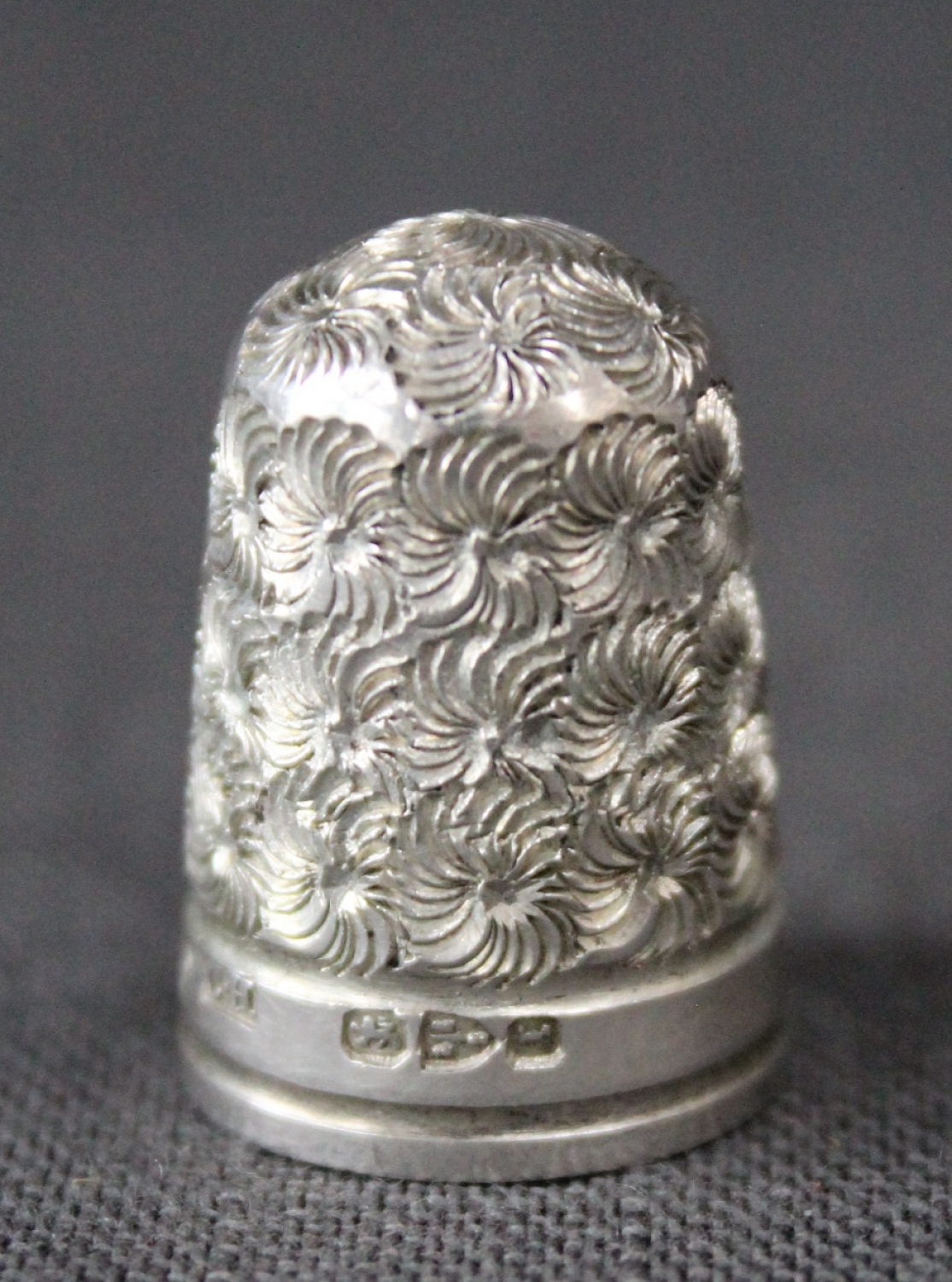 A late Victorian silver thimble