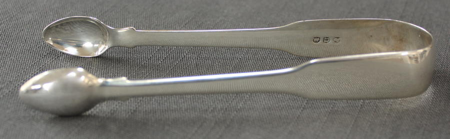 A pair of late Geo. III silver tongs