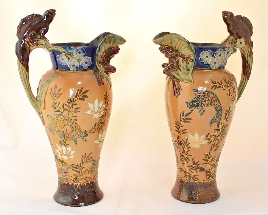 A pair of Doulton Lambeth ewers